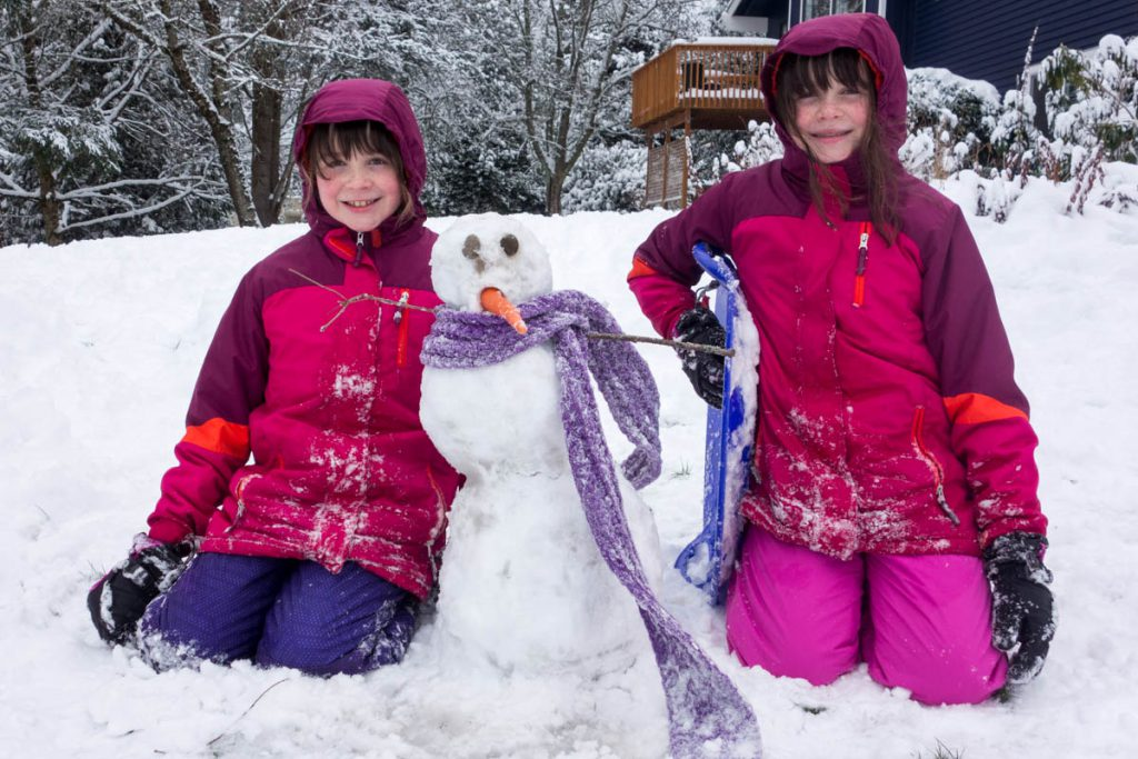 Nicolyn and Clara with their snowman.